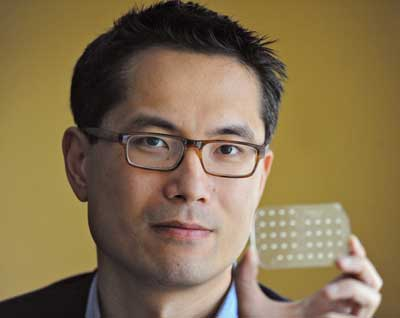 Samuel Sia holding an mChip device